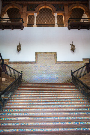 Saville Spain. Old Spanish Renaissance Revival staircase made of marble and wood.