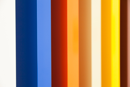 designates: Several colors in prospective painted on wood columns Stock Photo