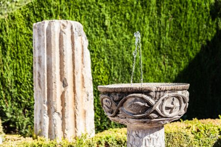 garden furniture: Roman ruins used as garden furniture in Italy