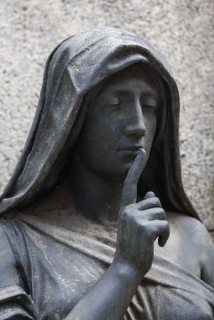 statue: More than 100 years old statue. Cemetery located in North Italy. Stock Photo