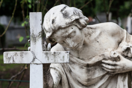 death: More than 100 years old statue. Cemetery located in North Italy. Stock Photo