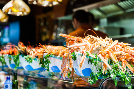 scampi: Interior of a busy fish market with detail on fresh scampi