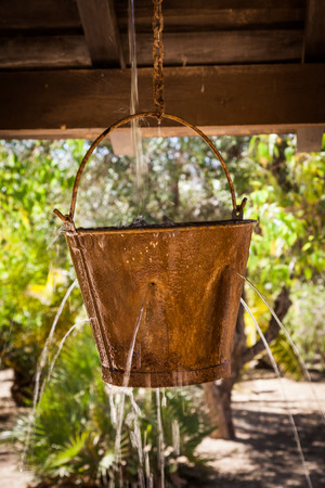 dangerous ideas: Very peculiar fountain with an old Far West design. Useful for concepts. Stock Photo