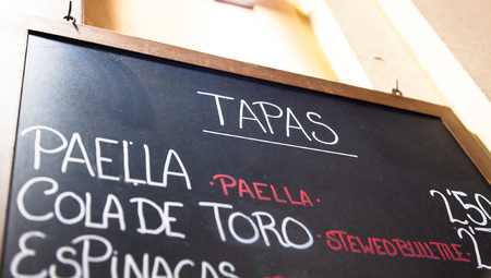showed: Walking in Barcelona - Spain - you can find this common menu purpose showed outside bars and restaurants.