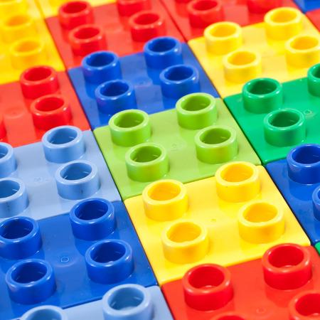 juguetes: Fondo de bloques de creaci�n pl�sticas.  Colores brillantes.