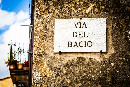 streetsign: Italy - Pienza town. The streetsign of Via del Bacio (Kiss Street)