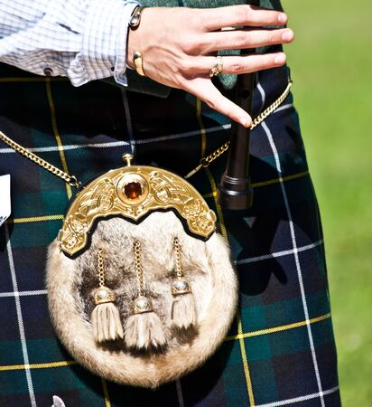 bagpipe: Detail of a bagpipe exibition during Highland Games