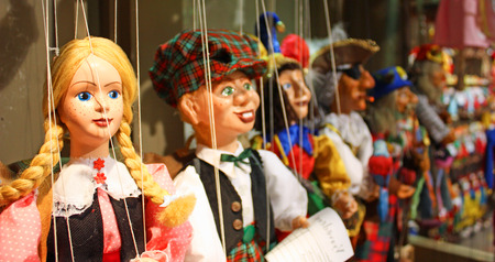 at the theater: Traditional puppets made of wood. Shop in Prague - Czech Republic