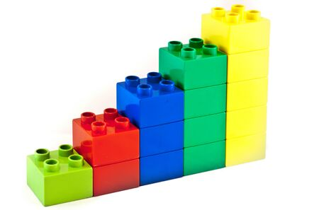 bright colors: Plastic building blocks on white background. Bright colors.