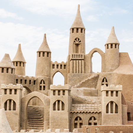 sandcastle: Grand sandcastle on the beach during a summer day