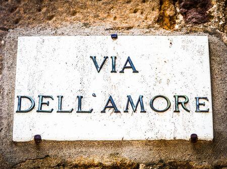 streetsign: Italy - Pienza town. The streetsign of Via dellamore (Love Street) Stock Photo