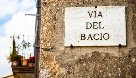 pienza: Italy - Pienza town. The streetsign of Via del Bacio (Kiss Street)