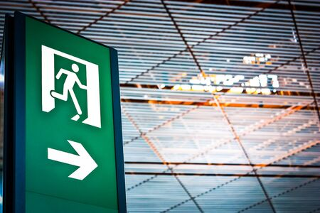 escape route: Sign of emergency exit in a Chinese airport, good for conceptual