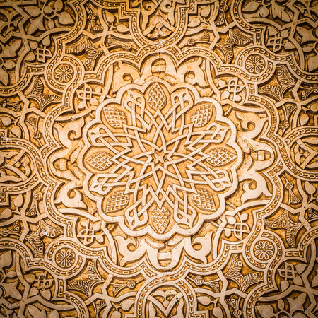 islamic calligraphy: Wall detail of Alhambra site in Granada - South of Spain. 600 years old arabic characters.