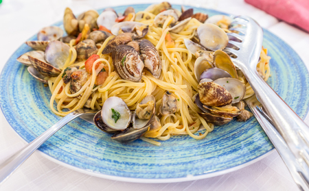 Restaurant in Naples, Italy. No photography set for this just arrived on the table Spaghetti alle vongole