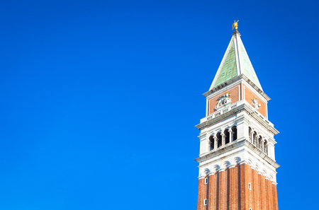 St Mark Campanile on blue sky with copyspace