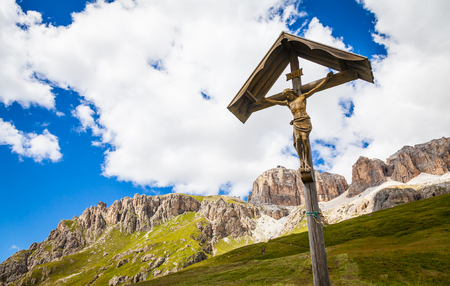 A 100 years old Crucifix, made of wood, tipical of Dolomity Region in North-East of Italy