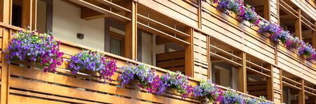 Traditional flowers setup on a Chalet in Trentino Region, Dolomiti Area, Italy Stock Photo