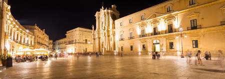 ortigia: Travel Photography from Syracuse, Italy on the island of Sicily. Cathedral Plaza. Large open Square with summer nightlife. Stock Photo