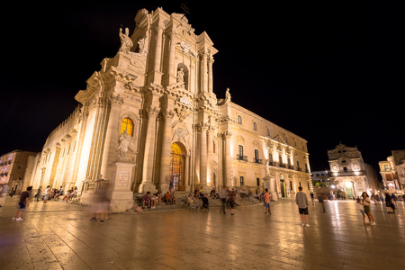 Travel Photography from Syracuse, Italy on the island of Sicily. Cathedral Plaza. Large open Square with summer nightlife. Editorial