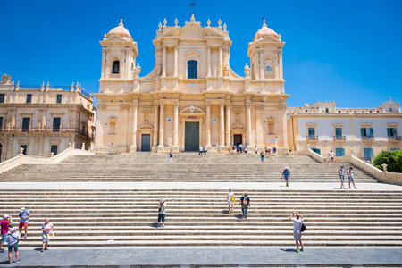 Turists in front of the most important baroque cathedral of Sicily, San Nicolò, Unesco Heritage site, sunny day Editorial
