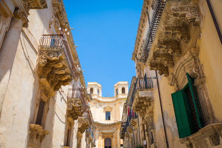Noto town in Sicily, the Baroque Wonder - UNESCO Heritage Site. Detail of Palazzo Nicolaci balcony, the maximum expression of the Sicilian Baroque style.