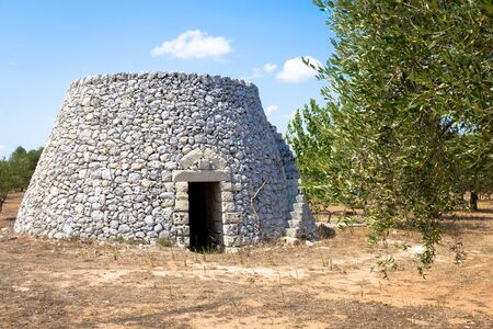 In Salento area, south of Italy, a traditional rural warehouse named Furnieddhu in local dialect. Its a traditional building made of stone in olives agricultural area.