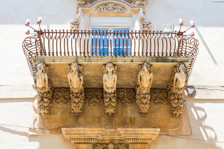 Noto town in Sicily, the Baroque Wonder - Detail of Palazzo Nicolaci balcony, the maximum expression of the Sicilian Baroque style. Stock Photo