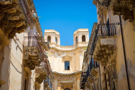 Noto town in Sicily, the Baroque Wonder. Detail of Palazzo Nicolaci balcony, the maximum expression of the Sicilian Baroque style.