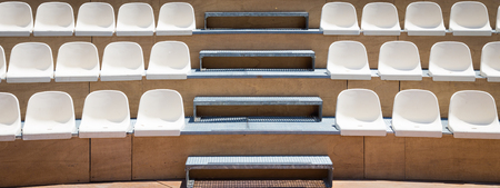 Open air theater with natural daylight; plastic seat rows Standard-Bild - 98079132