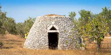 This traditional warehouse is named Furnieddhu in local dialect. All structure made of stone, used to repair agricultural tools in the country Stock Photo