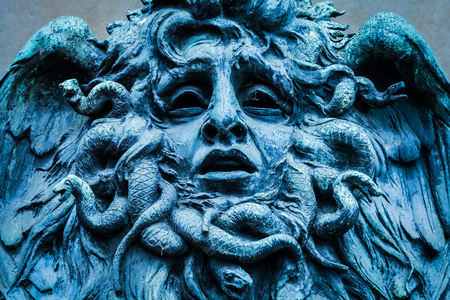 Italy, Turin. This city is famous to be a corner of two global magical triangles. This is a Medusas head made of bronze close to the historical garden of Valentino in Turin. Editorial