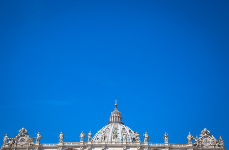 St Peter Basilica detail with a blue sky background for copy space - Rome, Vatican State
