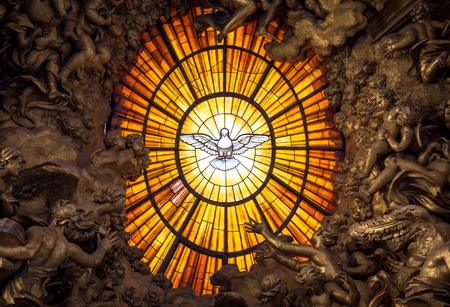 ROME, ITALY - AUGUST 24, 2018: Throne Bernini Holy Spirit Dove Saint Peter's Basilica Vatican Rome Italy. Bernini created Saint Peter's Throne with Holy Spirit Dove Stained Glass Amber in 1600s