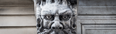 This city is famous to be a corner of two global magician triangles. This is a protective mask of stone on the top of a luxury palace entrance, dated around 1800, Italy, Turin.