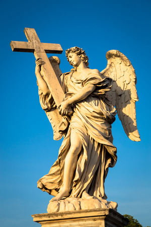 Rome, statue of an angel on the bridge in front of Castel Sant'Angelo. Conceptual useful for spirituality, christianity and faith. Imagens - 119232020