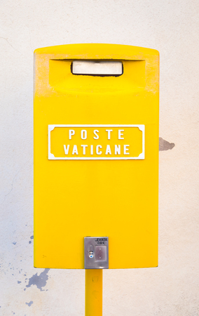 Detail of the traditional yellow post box in Vatican City, Rome