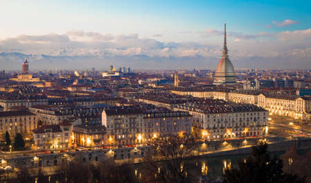 Turin, Piedmont Region, Italy. Panorama from Monte dei Cappuccini (Cappuccini's Hill) at sunset with Alps mountains and Mole Antonelliana monument.