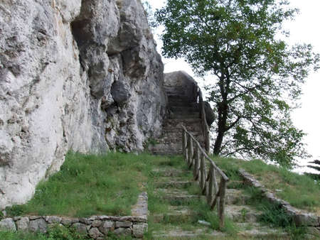 a stair that goes up the rock photo