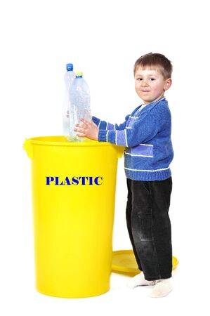 segregate: Young boy recycling plastic bottle Stock Photo