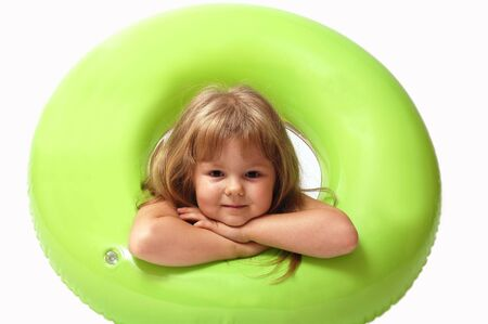 Young girl with green buoy on white background