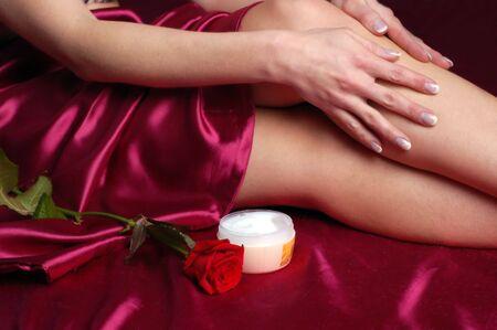 successfulness: Close-up of woman applying cream