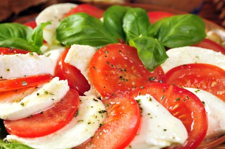 Fresh salad with mozzarella and tomatoes photo