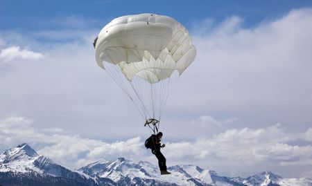 Parachutist on background of mountain
