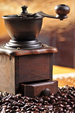 old coffee grinder and coffee beans Stock Photo - 3179943
