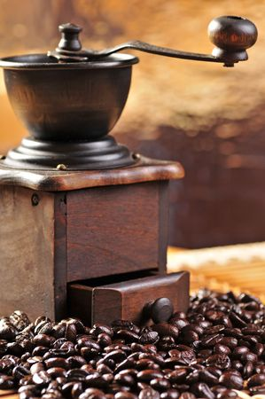 old coffee grinder and coffee beans photo