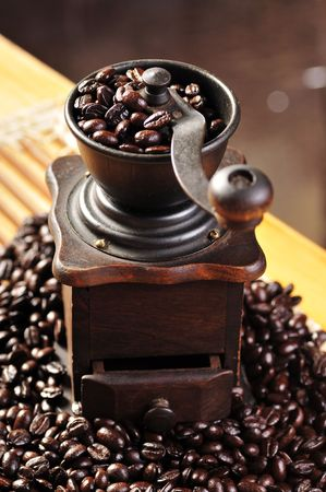 winnower: old coffee grinder and coffee beans Stock Photo