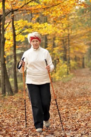Senior woman train nordic walking