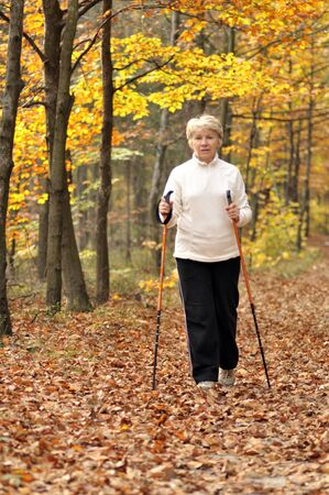 Senior woman train nordic walking