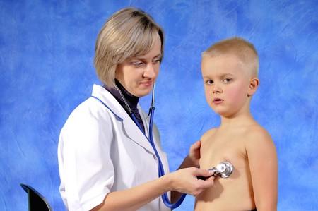 pediatrist: Female doctor examining child boy Stock Photo